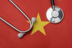 Vietnam flag and stethoscope. The concept of medicine. Stethoscope on the flag in the background royalty free stock images