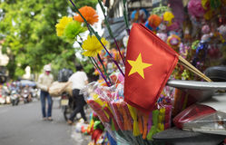 Vietnam flag on a street. Of Hanoi old quarter street royalty free stock images