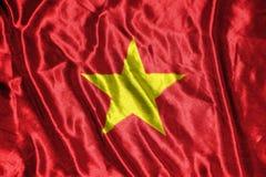 Vietnam flagga flagga på bakgrund Arkivbilder