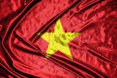 Vietnam flagga flagga på bakgrund Royaltyfria Foton