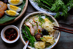 Vietnam food, egg noodle soup with wontons. Homemade Vietnam food, egg noodle soup with wontons, colorful food ingredient for this eating as egg, pork, broth stock images