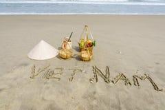 Vietnam geschrieben auf den Sand Stockbild