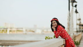Vietnam girl in the national red dress ao dai posing and smiling for vietnam girl in the national red dress ao dai posing and smiling for the camera on ccuart Gallery