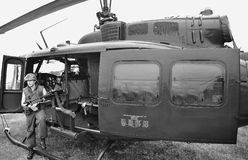 Vietnam grunt, downtime (re-creation). Nam grunt on downtime, leaning against the cockpit floor, in front of a Huey helicopter. This is a historic re-creation Royalty Free Stock Images
