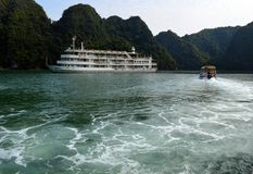 Vietnam - Ha Long Bay - Cat Ba Island -AUCO cruise ship and day boat. Ha Long Bay excursion on Cat Ba Island to Viet Hai. AUCO cruise ship and day boat amongst Royalty Free Stock Photos
