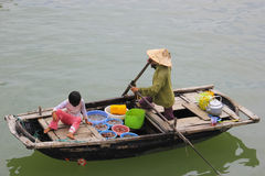 Vietnam, Ha Long Bay Floating Market. Picture taken at Ha Long Bay, Vietnam.  Where there is a floating market.  In this particular boat, the owner sells sea Stock Image