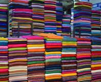 Vietnam - Hanoi - piles of fabric for sale at  Citys largest covered market, Dong Xuan Market. Vietnam - Hanoi - piles of material and fabric for sale at Citys Stock Photography