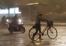 Hanoi Traffic in Heavy Rain Royalty Free Stock Images