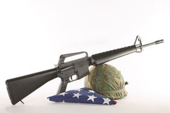 Vietnam Helmet and M16. Vietnam helmet with an M16 rifle on a white background Stock Photography