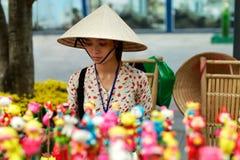 VIETNAM, HO CHI MINH - Vietnamese Woman Merchant Selling Souveni Stock Image
