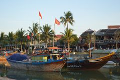 Vietnam - Hoi An- Scenic of the quayside and larger fishing boats on the Thu Bon River at sunset Stock Images