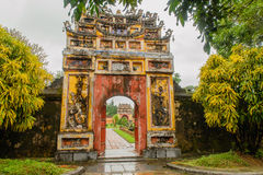Vietnam - Hue. One of the many historic gates in Hue Imeperial City, during a rainy day royalty free stock photos