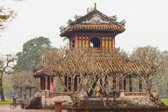 Vietnam, Hue. Phu Van Lau Pavilion in Hue Citadel. Phu Van Lau Pavilion behind the trees in Hue Citadel and is situated on the main axis of the Citadel. Seeing stock photo
