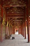 Vietnam - Hue - red and gold corridor at the Imperial Purple Forbidden city. Vietnam - Hue - Inside the Citadel is the ornate red and gold lacquer wood corridor Royalty Free Stock Photography