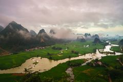 Vietnam landscape with rice field, river, mountain and low clouds in early morning in Trung Khanh, Cao Bang, Vietnam royalty free stock photography