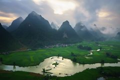 Vietnam landscape with rice field, river, mountain and low clouds in early morning in Trung Khanh, Cao Bang, Vietnam.  royalty free stock photography