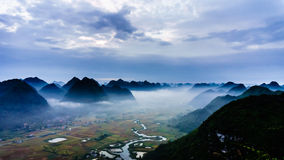 Vietnam landscape: Valley under fog in early morning-Bac Son-Lang Son-Viet Nam Royalty Free Stock Image