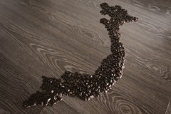 Vietnam map with coffee beans. With wooden background royalty free stock photos