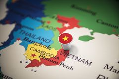 Vietnam marked with a flag on the map.  stock images