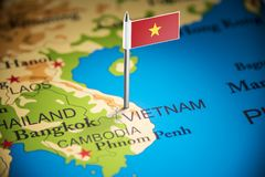 Vietnam marked with a flag on the map.  stock photography