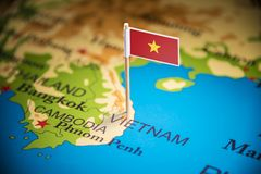 Vietnam marked with a flag on the map.  stock image