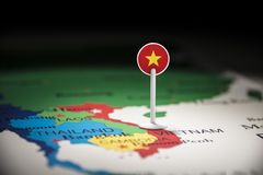 Vietnam marked with a flag on the map.  royalty free stock photos
