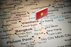 Vietnam marked with a flag on the map.  royalty free stock image