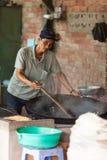 Vietnam, Mekong Delta-December 10, 2013. Man makes rice popcorn. Royalty Free Stock Photos