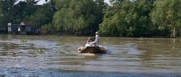 Vietnam, Mekong Delta floating market. People rowing boat on Mekong river Stock Photos