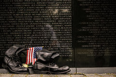 Vietnam Memorial. A pair of boots and US flag laid at the Washington D.C Vietnam memorial, on the anniversary of the fall of Saigon Royalty Free Stock Photo