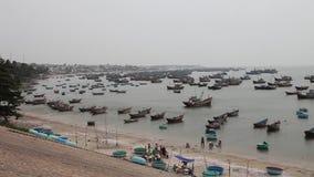 Vietnam, Mui Ne fishing harbor with fisherman boats December 28, 2013 stock footage