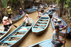 Vietnam people at the boats in Mekong Delta Royalty Free Stock Images