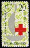 Vietnam postage stamp shows red cross medicine help, circa 1965 Stock Photos