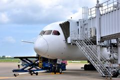 VietNam Saigon Airport operation. A Malindo Airlines plane is loading cargoes in VietNam airport, shown as industrial of transportation and cargo Stock Photography