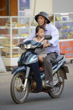 Vietnam Scooters with passengers Stock Image