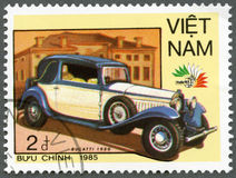 VIETNAM - 1985: shows Bugatti, 1930, series Vintage Italian cars. VIETNAM - CIRCA 1985: A stamp printed in Vietnam shows Bugatti, 1930, series Vintage Italian Royalty Free Stock Photos