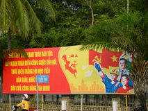 Vietnam socialist propaganda billboard on the street Royalty Free Stock Image