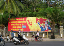 Vietnam socialist propaganda billboard on the street Royalty Free Stock Images