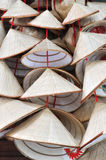 VietNam straw hat decoration. VietNam traditional style decoration, small straw hat in different size and repeated coniform shape, made by bamboo and other Royalty Free Stock Photo