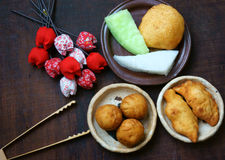 Vietnam street food, fastfood. Group of Vietnam street food: fried dumpling, quai vac cake, sponge cake make from wheat flour, good decoration on plate, wooden Stock Images