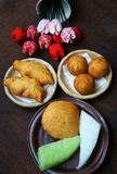 Vietnam street food, fastfood. Group of Vietnam street food: fried dumpling, quai vac cake, sponge cake make from wheat flour, good decoration on plate, wooden Stock Image