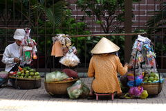 Vietnam Street Hawkers. Hawkers selling fruits and food on the streets of Vietnam Royalty Free Stock Photo