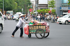 Vietnam street vendor pushing cart Stock Photography