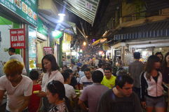 Busy streets at night. Many people are eating and drinking at a busy street in Hanoi during night royalty free stock images