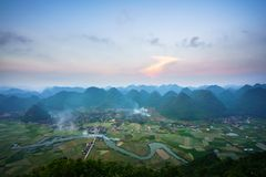 Vietnam sunrise landscape with rice field and mountain in Bac Son valley in Vietnam.  Royalty Free Stock Photography