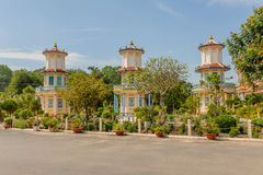 Vietnam - Tay Ninh. Three pagoda's in the garden of the Cao Dai Holy See Temple complex in Tay Ninh, against a blue sky Stock Photo