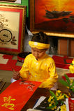 Vietnam tet, Asian kid, calligraphy fair Royalty Free Stock Photos