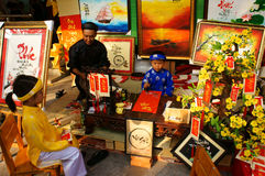 Vietnam tet, Asian kid, calligraphy fair Stock Photos