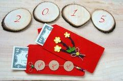 Vietnam Tet, sobre rojo, dinero afortunado Imagenes de archivo