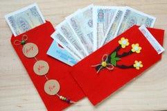 Vietnam Tet, sobre rojo, dinero afortunado Foto de archivo libre de regalías